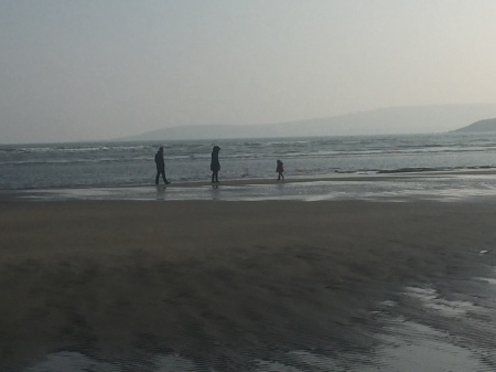 Family playing at Harbour View beach, West Cork